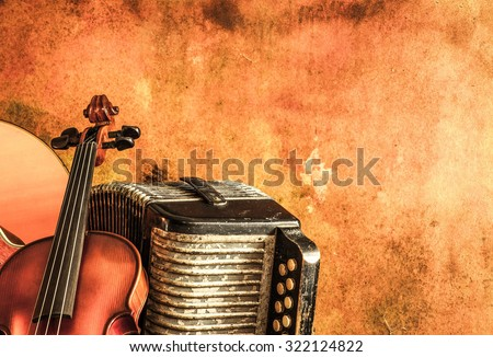 Vintage accordion and violin with still life style - stock photo