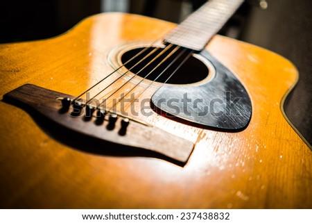 Vintage acoustic guitar - stock photo