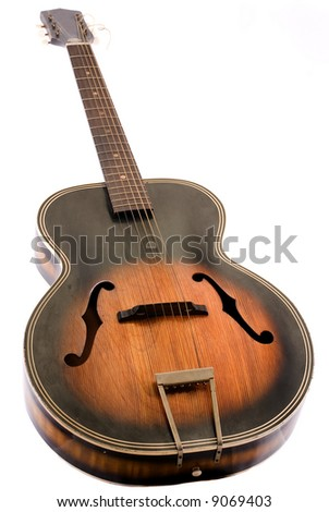 Vintage acoustic guitar on white background. - stock photo