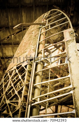 vintage aircraft rudder and airframe abstract - stock photo