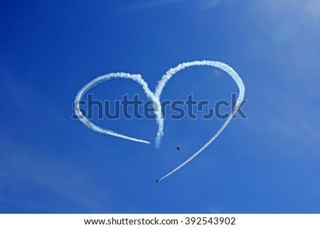 Vintage Aircraft Sky Writing Romantic Heart Shape. - stock photo