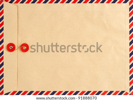 vintage airmail envelope. grungy background - stock photo