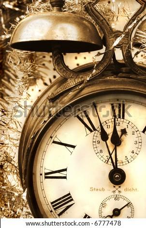 Vintage alarm-clock in sepia tone. New Year celebration - stock photo
