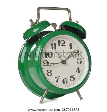 Vintage alarm clock isolated on white background - stock photo
