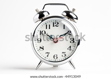 Vintage alarm clock isolated on white background