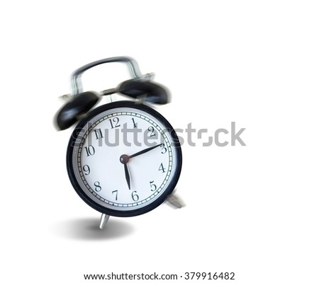 vintage alarm clock ringing and vibrating in the morning,wake up concept - stock photo
