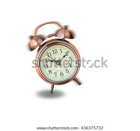 vintage alarm clock ringing and vibrating in the morning,wake up concept