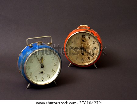 vintage alarm clock with broken glass
