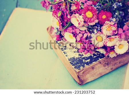 Vintage Albums with Photos of Memories with bouquet of flowers/ nostalgic vintage background