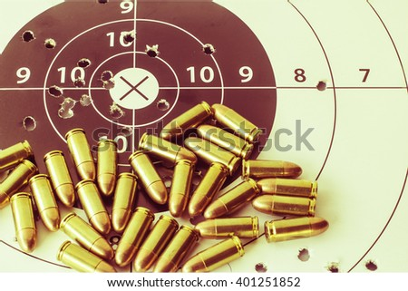 Vintage ammunition and gun target - stock photo