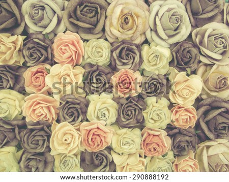 Vintage and blur style photo of the paper beautiful roses background for decorate the wedding ceremony. - stock photo