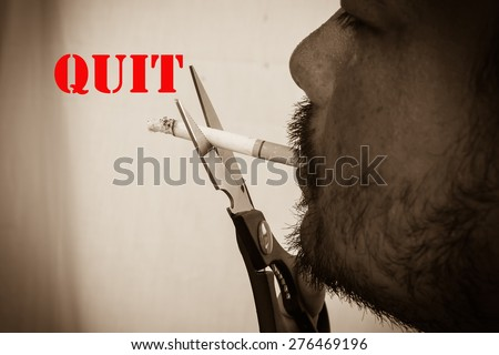 vintage and old photo concept man use scissor cutting cigarette quit smoking  - stock photo