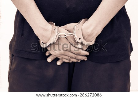 vintage and old photo - concept rape woman - woman hand in handcuff close sexual  - stock photo
