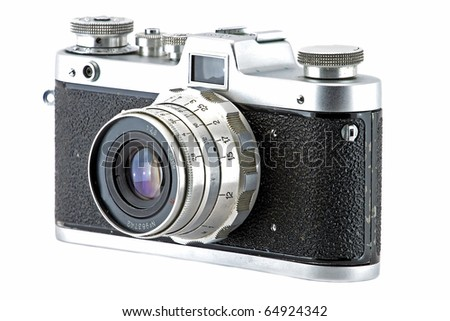 Vintage and retro camera (side view) isolated in white - stock photo