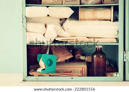 Vintage antique first aid kit on wooden table. filtered image  - stock photo
