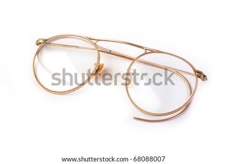 Vintage antique glasses on white background - stock photo