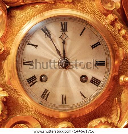 Vintage antique golden clock face, closeup. - stock photo