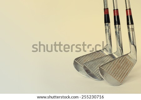 Vintage, antique golf driver (putter) and ball. golf club. retro paper background (toned) - stock photo