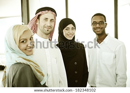 Vintage Arabic business people working in office - stock photo