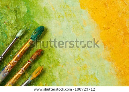 Vintage artists brushes on an abstract artistic background - stock photo
