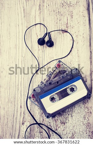 vintage audio cassette with heart on wooden background