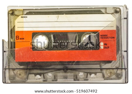 Vintage audio compact cassette with broken box isolated on a white background