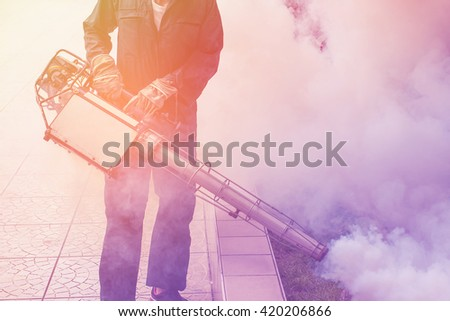 Vintage background fogging to eliminate mosquito for prevent spread dengue fever - stock photo