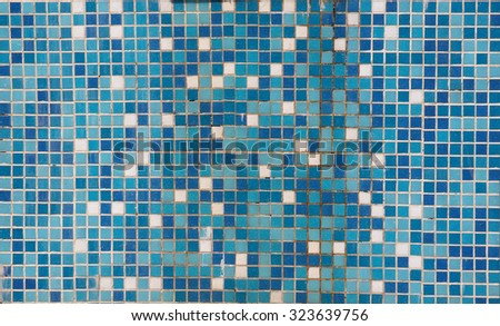 Vintage background old mosaic wall texture different color stone elements