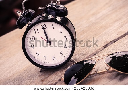 Vintage background with  alarm clock - stock photo