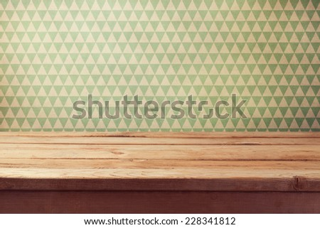 Vintage background with empty wooden table over wallpaper - stock photo