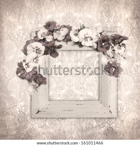 vintage background with frame  and flowers in sepia - stock photo