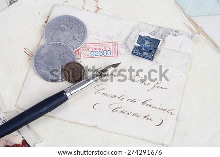 Vintage background with old paper, old ink pen, handwriten letters and silver coins