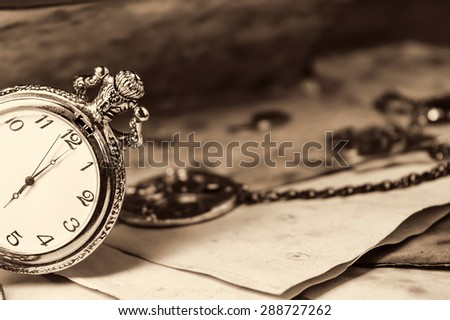 Vintage background with old watch - stock photo