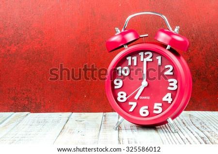 Vintage background with retro alarm clock on table - stock photo