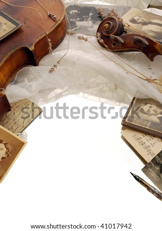 Vintage background with violin and old photos - stock photo