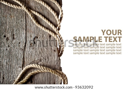 Vintage background with wooden log and hemp rope on isolated white background - stock photo