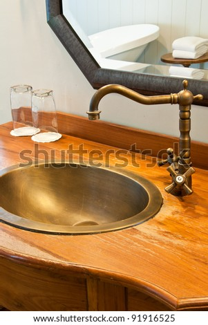 Vintage bathroom faucet on brass water basin