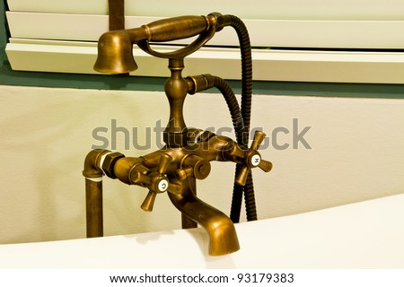 Vintage bathtub faucet - stock photo