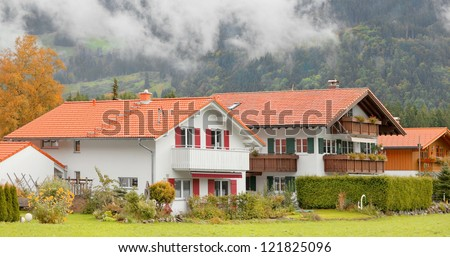Vintage Bavarian houses in the alpine village of Langenwang, Germany