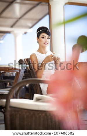vintage beautiful woman in restaurant cafe cup of coffee.Healthy drink for breakfast.Stylish rich slim girl in retro dress. glamorous romantic lady at vacation. Woman on date.Retro style.France.series - stock photo