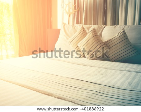 vintage bed sheets and pillow messed up in the morning and color tone effect - stock photo