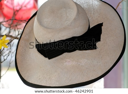 Vintage Beige hat with black ribbon - stock photo