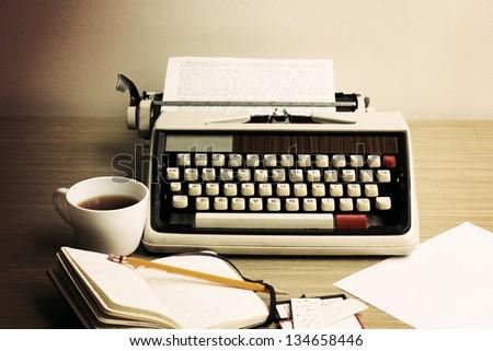 Vintage beige typewriter - stock photo