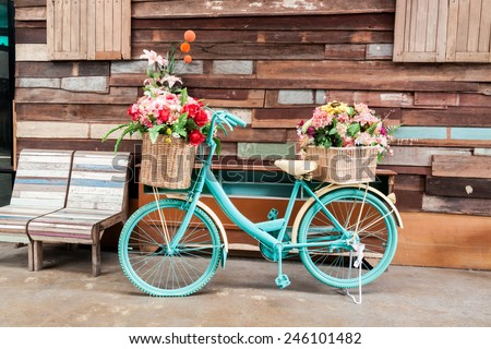 vintage bicycle on vintage wooden house wall - stock photo