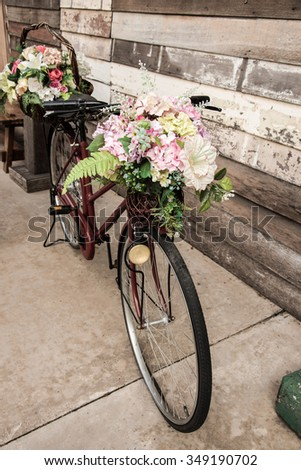 Vintage bicycle with flower basket - stock photo