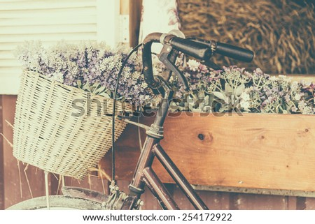 Vintage bicycle with flower - vintage effect filter style pictures - stock photo