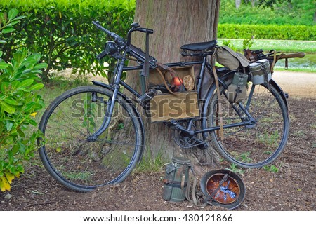 Vintage bicycle with World War 2 German Equipment Including Machine gun and Helmet. - stock photo