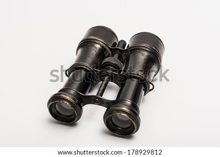 Vintage binoculars on a white background - stock photo