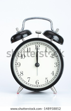 Vintage black  color alarm clock  on the write background