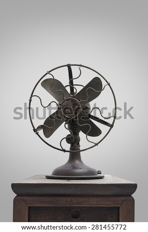 vintage black electric fan on gray background - stock photo
